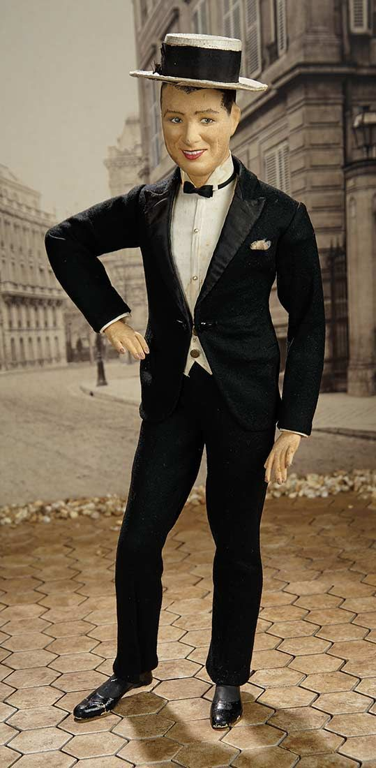 "24"" papier-mâché Maurice Chevalier portrait doll, based on the likeness of the French actor and cabaret singer, France, 1930-35, maker unknown."