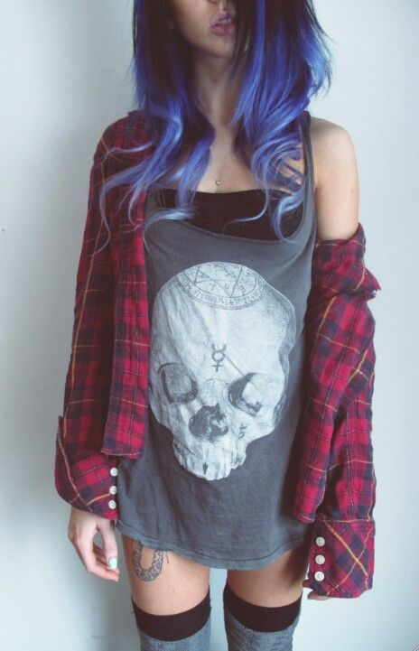 Rockin' it with plaid and purple hair.
