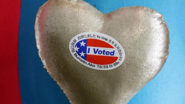 """An """"I Voted"""" sticker is displayed on Whirlie the Clown's outfit at the Luxe Hotel in Los Angeles. (Mike Nelson / EPA)"""