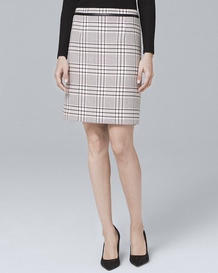 33c39bee3d We took classic plaid and stepped up its cool factor with black faux  leather trim. | My closet | Skirts with boots, Skirts, Black faux leather
