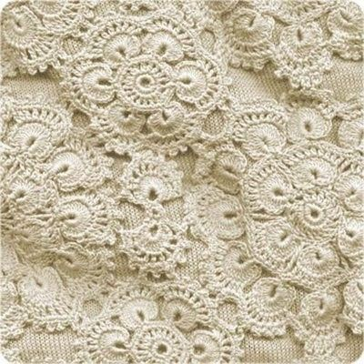 "African Flower motifs in ivory.  reminds me of my mom.she was never without her HOOK...mostly did   ""filet"" crochet"