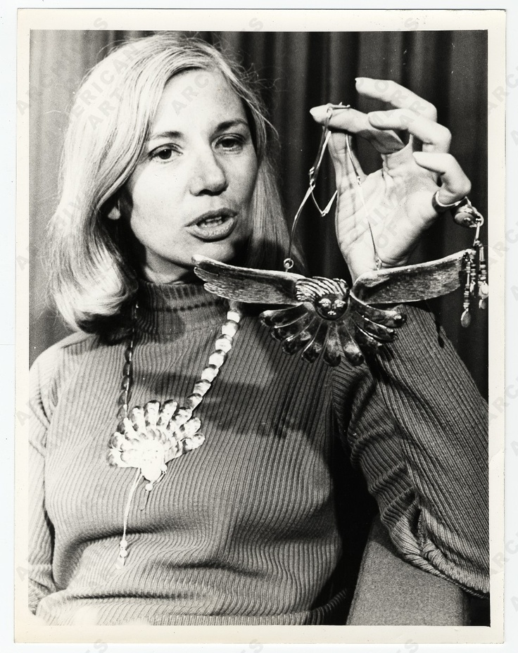 Arline Fisch holding a necklace, 1972.