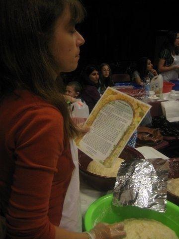 Fulfilling the mitzvah of hafrashas challah at our Long Island Jewish center.