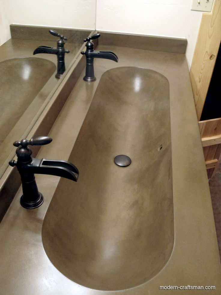 Modern & contemporary bathroom sink with concrete and wood by Modern Craftsman Tyler Blaine