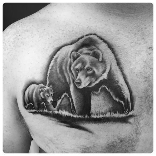 realistic black and gray grizzly father tattoo and the cub