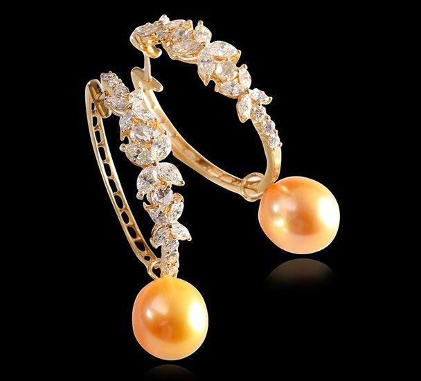 Diamond & South Sea Pearl Earring  Diamond and south sea pearl earring set in 18k yellow gold.