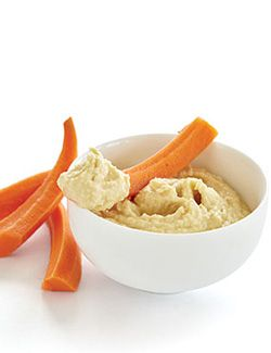 Hummus recipe without the fat. (1/2 cup of commercial hummus has 12 grams of fat - which makes 52% of that serving fat.)    2 cans chick peas, rinsed and drained   • 3 cloves garlic   • Juice of 1 lemon   • 2 teaspoons ground cumin   • 2 teaspoons Bragg Liquid Aminos   • 1/4 cup water or vegetable broth