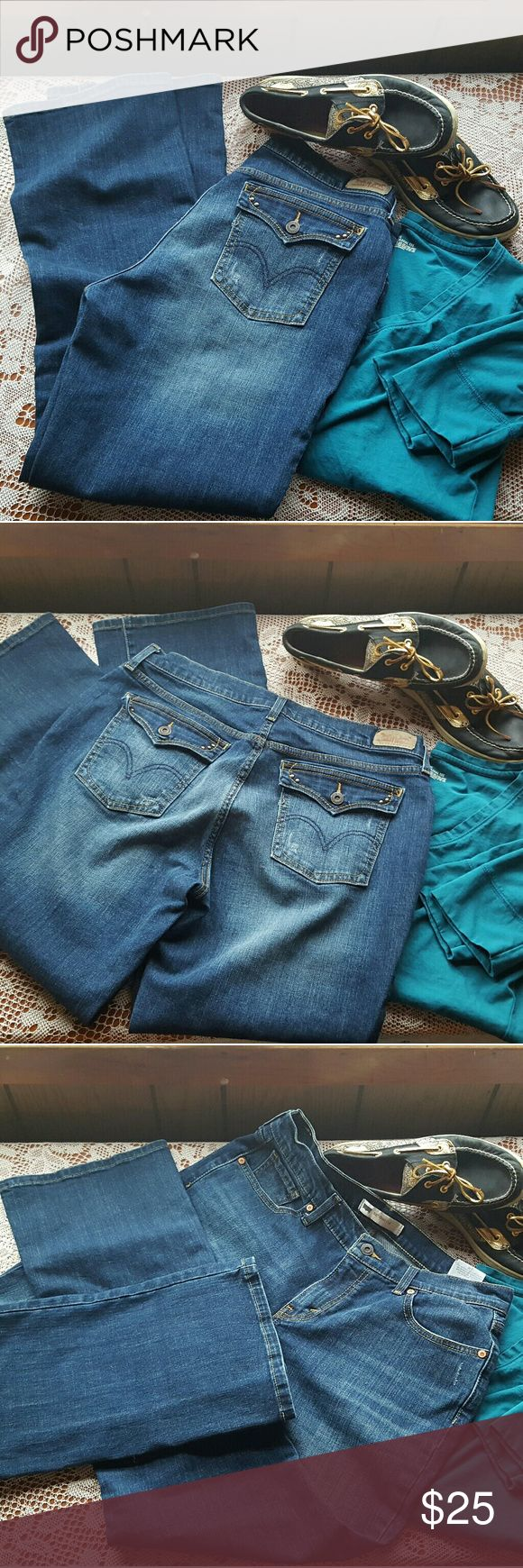 Levi's 515 womens bootcut jeans like new Levi's 515 women's bootcut jeans slightly distressed size 12M Levi's Jeans Boot Cut
