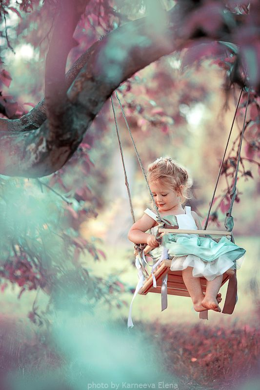 Precious Little Girl in Tree Swing- like the foreground