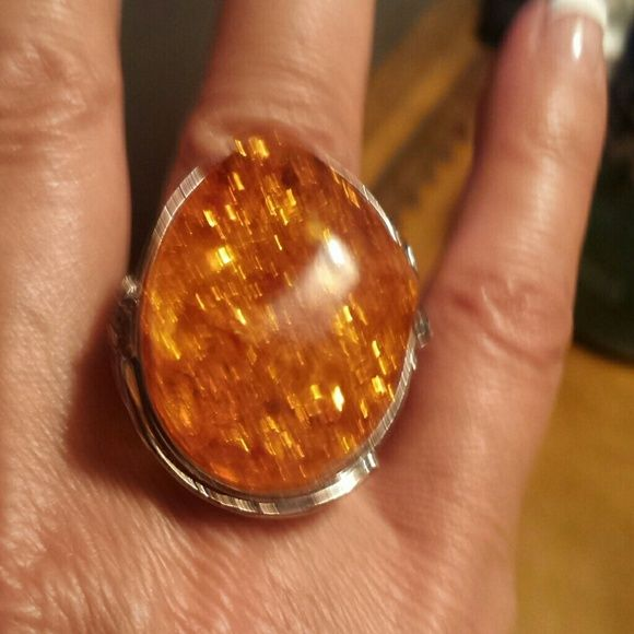 "FINAL MARKDOWN STATEMENT RING Silver tone ring with intriquite detailing holding an ""Amber"" style center stone. I did a double take on this ring. It's made so well I was almost sure the center was Amber. Not your average costume more like a dinner ring. Jewelry Rings"