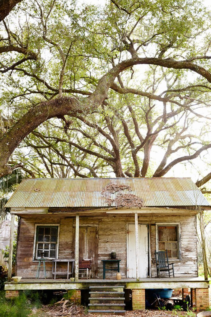 Originally built in the 1840s, this Creole cottage sits between a sugarcane field and Bayou Teche in Franklin, Louisiana