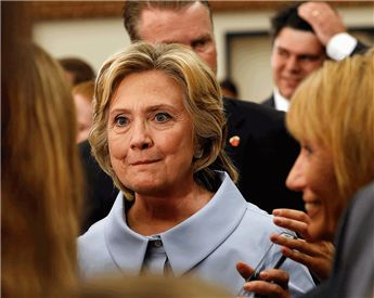 Democratic presidential candidate Hillary Clinton talks with students during a campaign stop at the University of New Hampshire on Friday.  AP