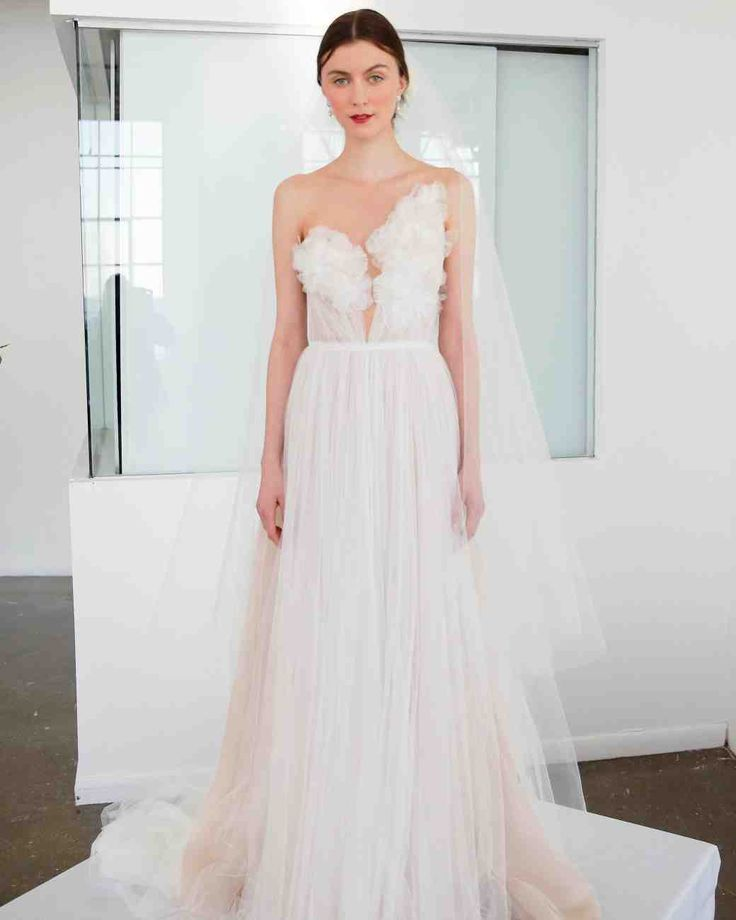 43 Romantic Floral Wedding Dresses   Martha Stewart Weddings - This A-line, hand-draped tulle gown with an illusion yoke boasts intricate 3-D rose flower embroidery. Plus we love the peek-a-boo sheer bodice details.