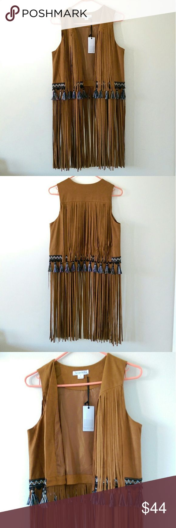 Boho long fringe festival vest Stay festival ready in this amazing fringe vest with tassels and embroidered details. Brand new with tags. Vest bodice is lined inside. Super fun for the summer. Excellent condition, only flaw is shown in last picture, missing one fringe tassel. Cannot see when worn. Loveriche Jackets & Coats Vests