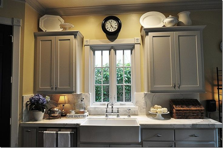 Ok - love this kitchen even better....  Love the gray and yellow 2gether........I would distress the cabinets a bit more though.