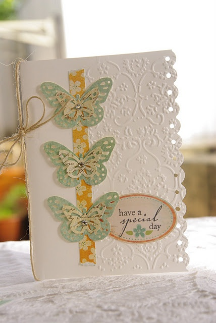 Layered butterflies on ribbon--edge punched
