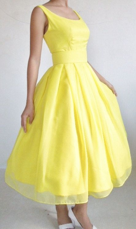 Yellow dress with a boat neckline and knee length pleated skirt. Makes a beautiful little bridesmaid dress or alternative gown .