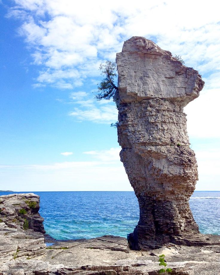 "This is one of the ""flowerpot"" rock formations on Flowerpot Island just off the coast of Tobermory! More of my favourite things to see and do in Tobermory is up on my blog today!"