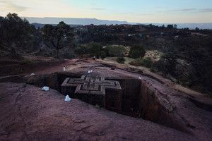 Pilgrims-sit-above-the-Saint-George-rock-church-in-Lalibela-Ethiopia.jpg