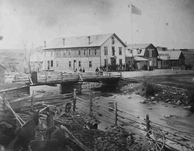 Buffalo, 1883, showing an early bridge over Clear Creek and an early version of the Occidental Hotel. Johnson County Jim Gatchell Memorial Museum.