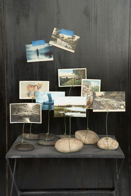 Love this idea of wrapping florist wire around some river rocks to become photo stands by Danny Seo.  Especially holding vintage postcards. Read more about it here. Via Poppytalk
