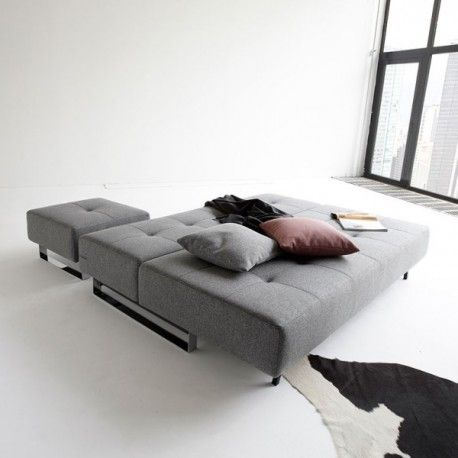 SUPREMAX DELUXE LOUNGER QUEEN SOFA BED ~~~ This three-seater model features pin-cushion embellishments and an iconic chrome steel legs. Its stylish, ultra-modern design is complemented by exquisite craftsmanship and materials.