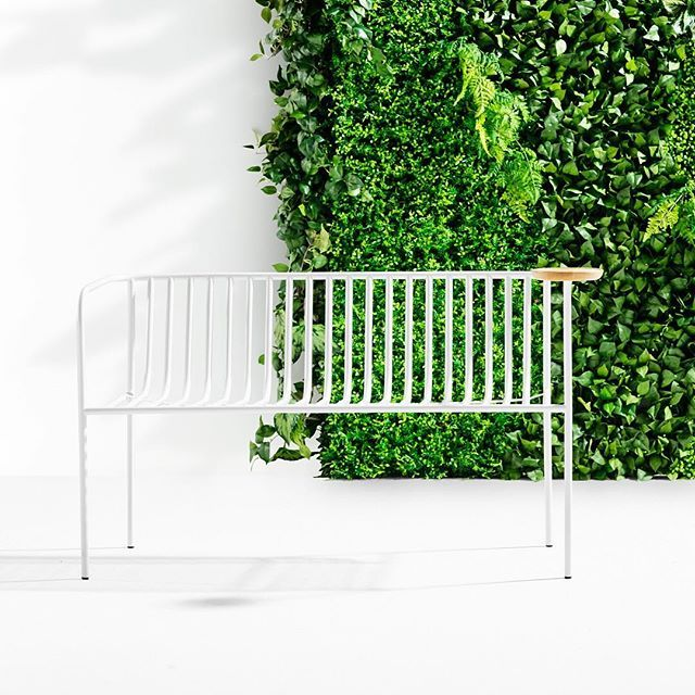 A simply elegant outdoor seating range, with a lightness that invites easeful relaxing. A subtle curved back, and leg detail that becomes a bag hook or base for a side table, brings a considered classiness to casual outdoor lounging.