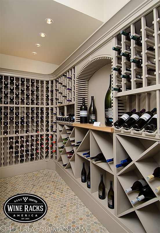 An all-wood wine cellar with a very modern look, this cellar has a bit of everything. The high-reveal display rows show off some of their best vintages while the solid bins allow them to store more bottles in less space. One of the best looking cellars we have seen!