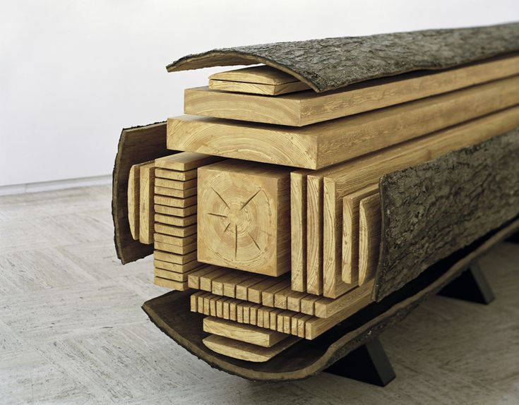 "Artist Vincent Kohler created a sculpture ""that demonstrates an exploded view of the inner workings of a tree. Sectioned into various arrangements, the composition highlights the several different cuts of lumber - including the center pith and other vertical and flat grain pieces."""