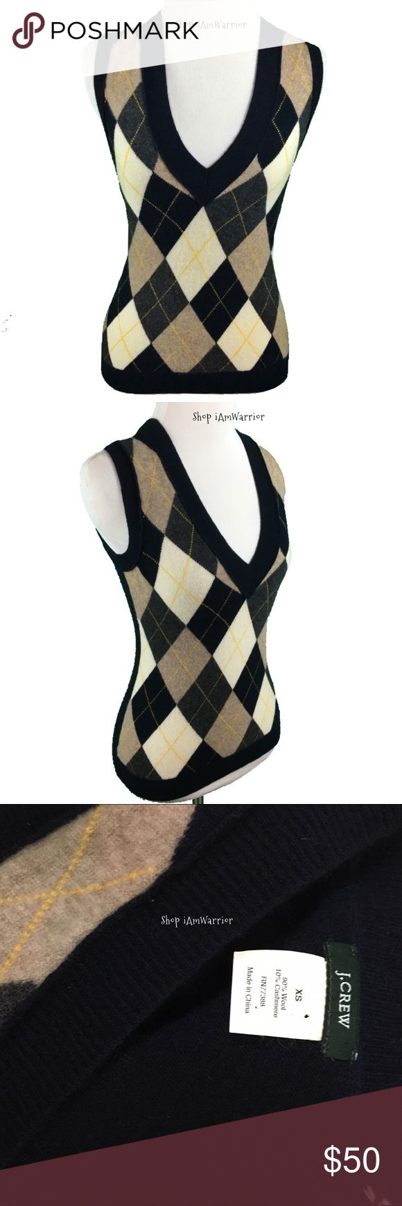 J Crew cashmere blend argyle sweater vest Great little navy blue cashmere blend sleeveless sweater from J. Crew (actual store not J. Crew factory as indication by single dot on tag). Has ivory and tan argyle print on front. Great condition. Looks great layered with long sleeve t-shirt, turtleneck or crisp button down and dark wash denim. J. Crew Sweaters