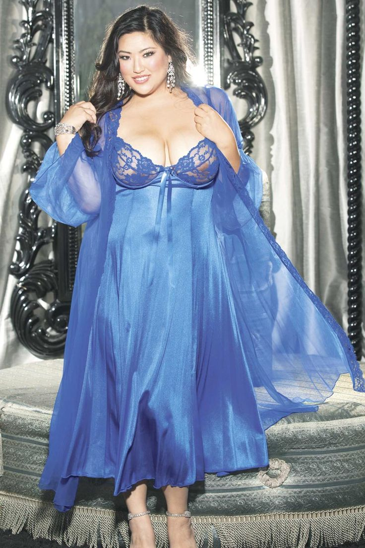 Show your sultry side with this BBW lingerie that features a long, satin night gown as well as a matching satin and sheer robe. The nightgown itself includes sheer lace cups with underwire for a better fit and a satin bown in the center. Straps are adjustable. The skirt is seamed for a figure-flattering fit and features extra soft 15 denier fabric. The matching robe for this full figure lingerie includes sheer, long sleeves and a satin 15 denier design. This flowing set will show of your…