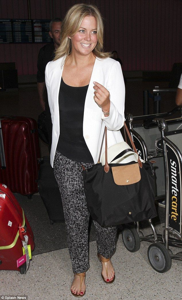 Feeling fresh! Samantha Armytage was bright, breezy and make up free when she arrived in L...