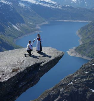 """The world's best place to get a """"yes""""! - """"The Troll's Tongue"""" -Trolltunga, Skjeggedal, Hordaland Fylke, Norway. The Lonely Planet has listed the world's 10 best places to propose, with Trolltunga as the second top place.  """"Trolltunga is a dramatic sliver of rock that extends precipitously over a 700m abyss and overlooks the lake of Ringedalsvatnet far below.""""  Makes it definitely difficult to say """"NO""""!"""