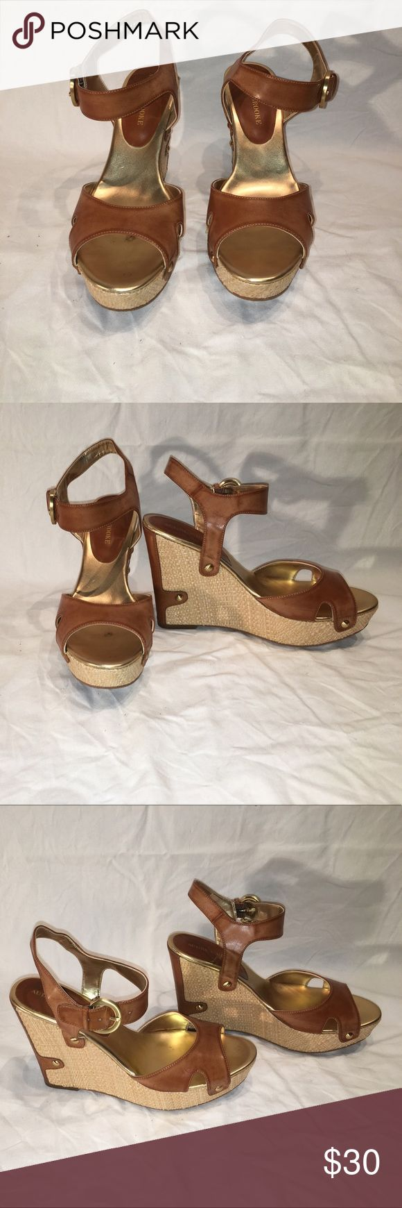 Brown leather wedge sandals Adorable brown leather wedge sandals with ankle straps and leather detail on heel. Hardly worn. Pretty brushed gold hardware. Audrey Brooke Shoes Sandals #sandalsheelswedge