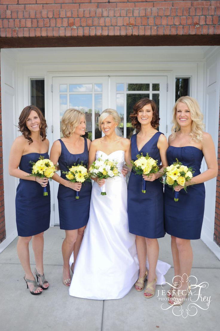 Navy bridesmaids - dresses from J Crew. Like bouquets too (bride = white and yellow, maids = just yellow) Tri delta wedding?!?!