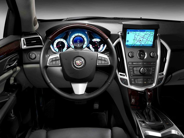 Cadillac SRX interior - Love my new baby!!! :)  all the same but I have cream and chocolate instead of grey and black...seats will be much cooler in the summers!!!