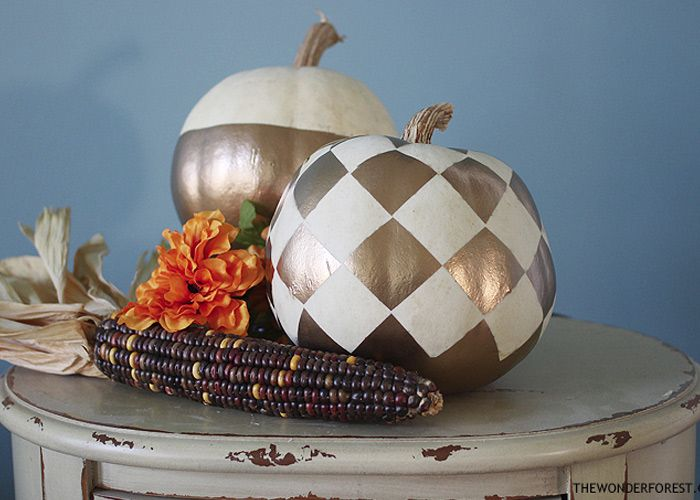 "Yesterday I showed you a really easy way to get a gold ""dipped"" pumpkin, and today I am taking it up a notch with a checkered diamond pattern!  I just used the same spray paint and some white address labels to get this look. I think it complements the other gold pumpkin perfectly."