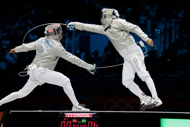 Italy's Diego Occhiuzzi, left, competes with Hungary's Aron Szilagy during the gold medal match in the men's fencing individual sabre at the 2012 Summer Olympics, Sunday, July 29, 2012, in London. (AP Photo/Dmitry Lovetsky)