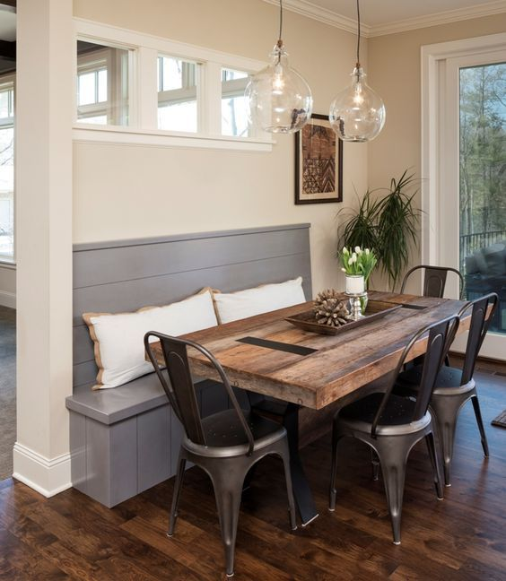 The Tolix Tabouret chairs bring a unique and timeless charm to this breakfast nook. Via Great Neighborhood Homes.: