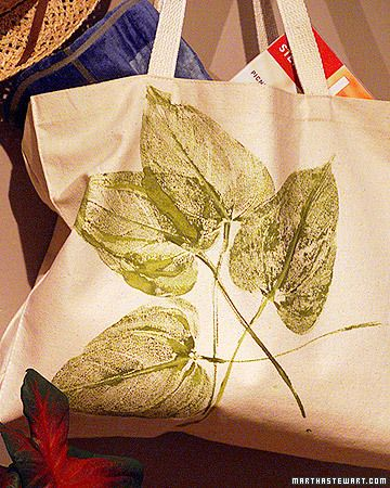 Leaf Print Tote Bag.Undamaged leaves,when covered with a coat of fabric paint,make unusual+varied imprints on absorbent textiles,eg:canvas/cotton/linen.Martha used a bay leaf in a diamond pattern to embellish a plain canvas tote bag.Look for green,pliant,sturdy leaves eg:magnolia/eucalyptus.Before u begin applying the paint,u may want to make a template of your leaf+use it to trace your pattern in pencil on the tote bag.That way you'll avoid misprinting the painted leaf.