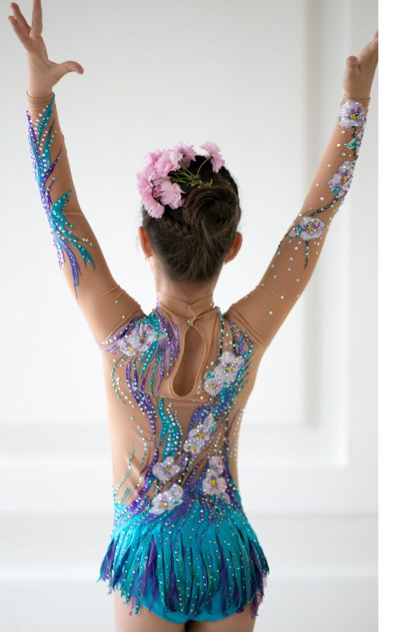 Beautiful designer rhythmic gymnastics leotard handmade. Shown as an example of work we do. Enquire about your custom leotard today. The leotard for the rhythmic gymnastics competition made with over 3500 rhinestones very high quality. Design drawing on fabric acrylic paints. Execute the order. Handmade product thats why every item might have different color and shape.
