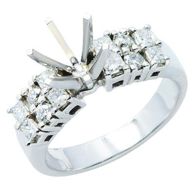 This beautiful 14K white gold ring features a 6 prong semi mount that can fit  7.1 mm round cut center stone. Each side of the band features six stunning princess and brilliant round cut, prong set diamonds (for a total of 12 diamonds).Different head sizes may be available to fit different sized and shaped stones.Different ring sizes may be available. Please inquire for details.