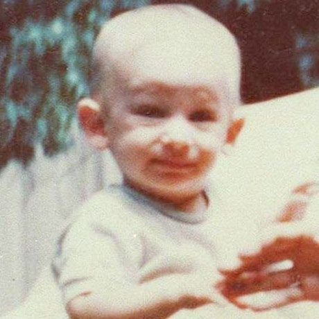 Before he was a Hollywood movie mogul -- he was just another bouncing baby growing up in Cincinnati, Ohio. Can you guess who it is?