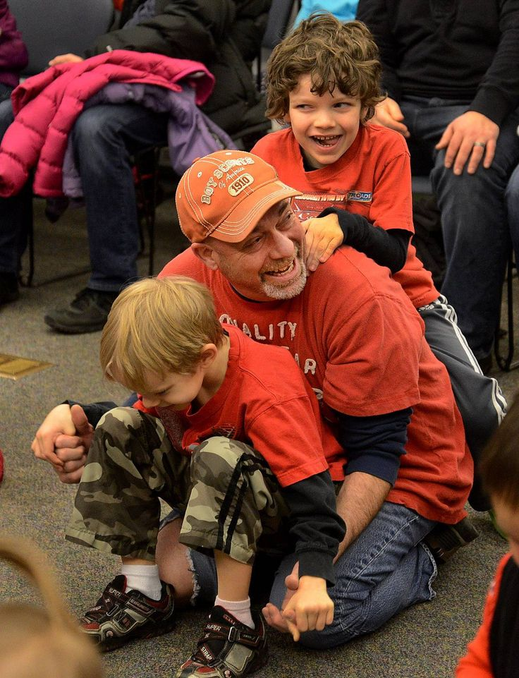 """Stephen Narens of Wheeling jams with his sons, 8-year-old Devitt, below, and 7-year-old Collin, during Jiggle Jam with Jodi Koplin, an interactive """"MusicFest for Children"""" at the Indian Trails Public Library District in Wheeling on Tuesday."""