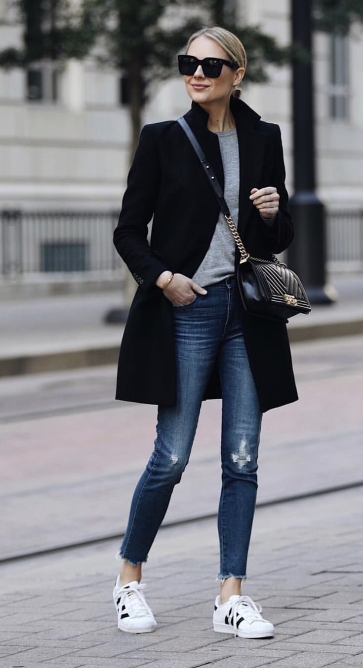 classic style with chanel boy bag and black coat, jeans, and Adidas