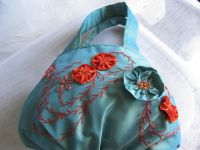 Tourquoise polyester bag with orange and turquoise floral mitif