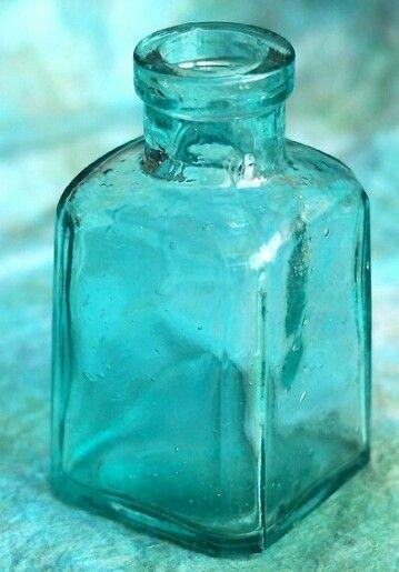 Turquoise glass bottle
