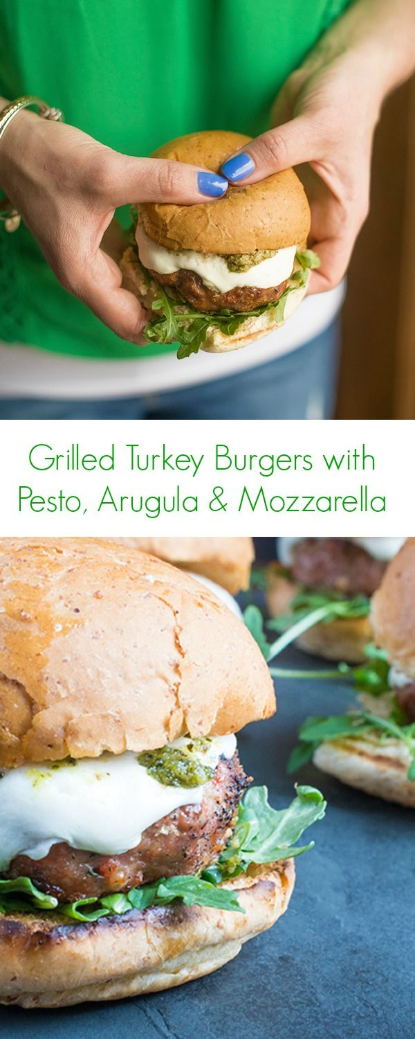 These juicy grilled turkey burgers are topped with fresh pesto, spicy arugula and creamy mozzarella cheese.