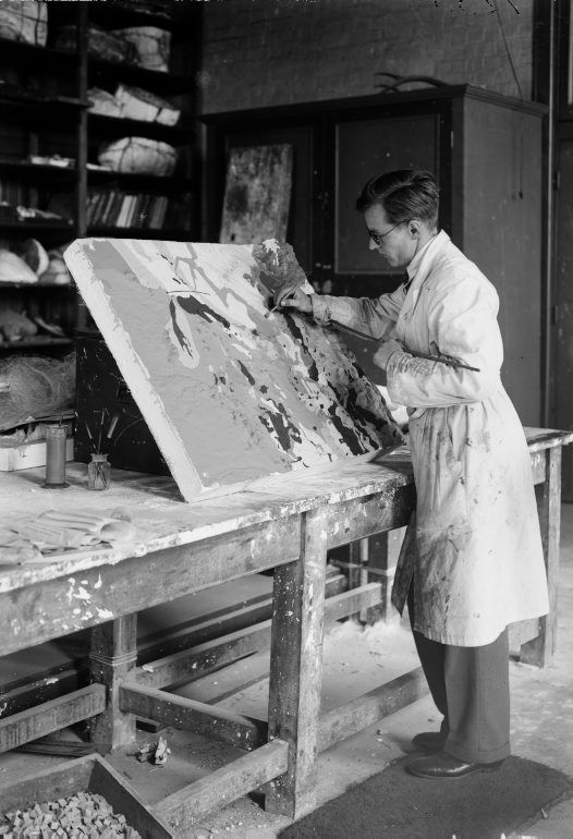 Oliver Chalmers painting a geological relief map