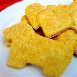 Save money and concern for what you're giving your dog by making these dog treats using canned pumpkin, peanut butter, cinnamon, and whole wheat flour.